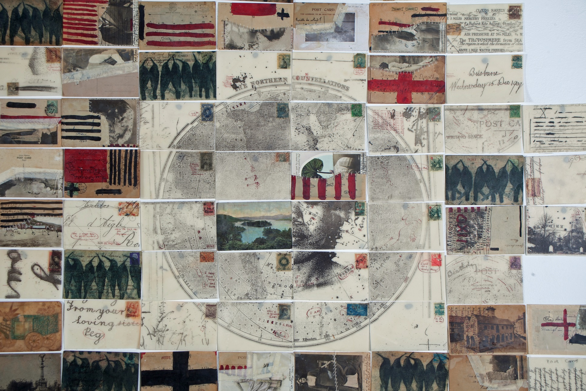 Glen Skien, Archive of the Unfamiliar, 2013, altered postcards, thread, ink, encaustic, dimensions variable. Courtesy of the artist.